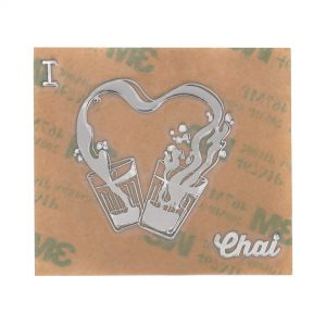 front view of chrome coloured i love chai metal sticker