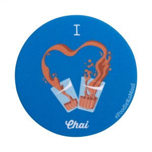 blue colour badge or fridge magnet with i love chai printed on it