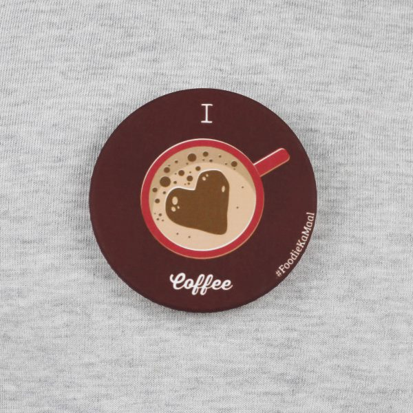 front view of brown colour badge or fridge magnet with i love coffee printed on it