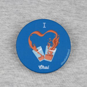 front view of blue colour badge or fridge magnet with i love chai printed on it