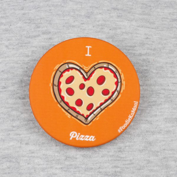 front view of orange colour badge or fridge magnet with i love pizza printed on it